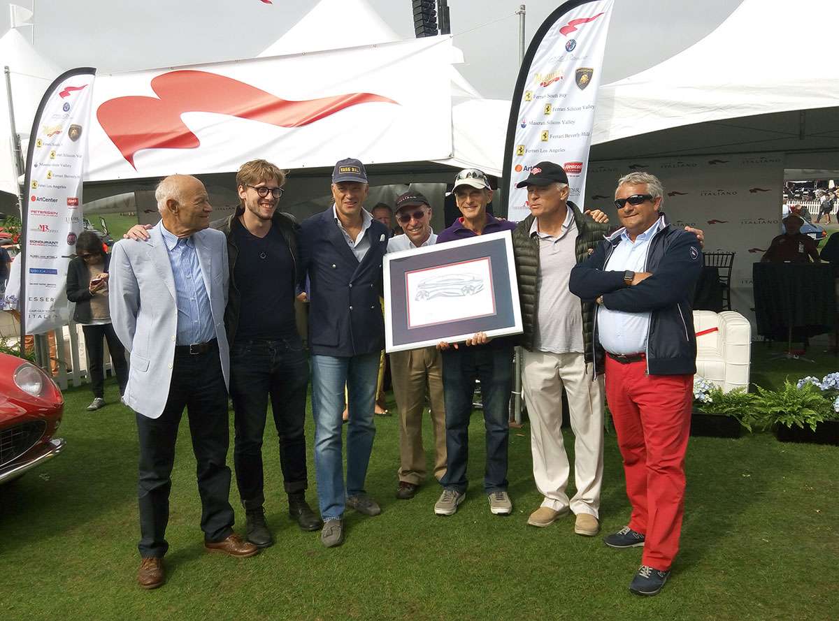 "Egidio Reali (on the right) with the winner of the ""Best in show"" awards and all the people who and all the people who contributed to the creation of the sculpture."